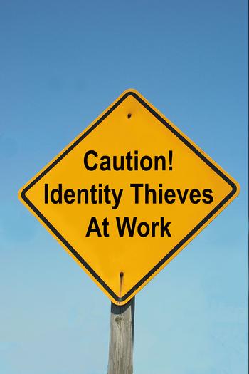 bigstockphoto_Caution_Sign_-_Identity_Thieve_1883834