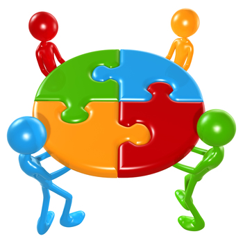 Working Together Teamwork Puzzle Concept