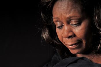 African American Woman Looking Down
