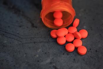 Spilled Orange Pills and Medicine Bottle