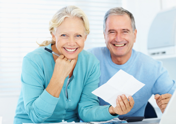 Happy senior couple planning household financials