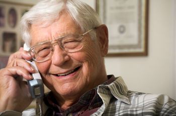 senior man talking on telephone