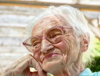 Very old woman telling a joke