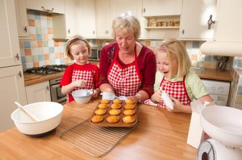 Grandmother and Girls Baking Cupcakes