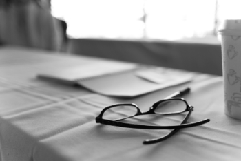Spectacles and coffee cup in black and white