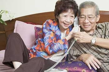 senior-couple-on-phone