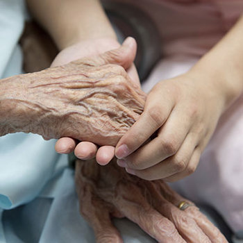 old-and-young-touching-hands