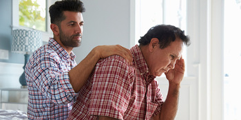 Thinkstockphotos-519664398-son-comforting-father-with%20dementia.jpg