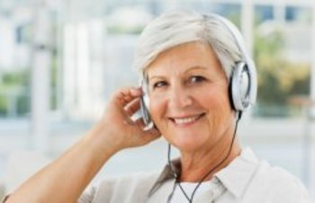 Smiling senior woman listening to music
