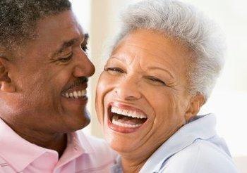 Couple relaxing indoors laughing HOME PAGE