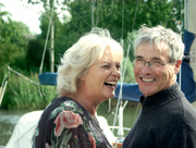 happy retired couple on a boat